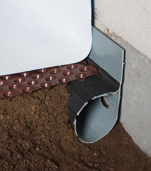Closeup of a crawl space drainage system installed in Crawfordsville