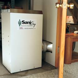 A basement dehumidifier with an ENERGY STAR® rating ducting dry air into a finished area of the basement  in Frankfort